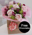 FREE chocolates and prize draw entrance with selected bouquets from M&S